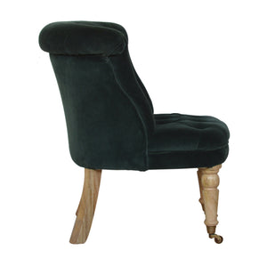 Aurora Accent Chair in Emerald Green Velvet. Hand-crafted to perfection. Elegant chair that matches your classic home. Exclusively available at thecarpenters.co.uk.