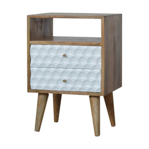 Nordic Honeycomb Carved 2-Drawer Bedside Table with Open Slot. Beautifully hand-carved bedside table with open slot. Perfect for any bits and pieces near your bed. Exclusively available at thecarpenters.co.uk.