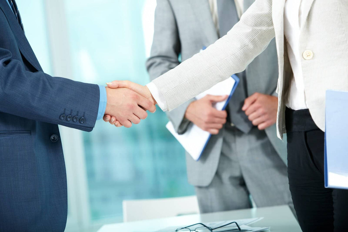 Business men in suits shaking hands