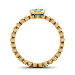 Fairtrade Gold FAITH Blue Topaz Stacking Ring - Jeweller's Loupe