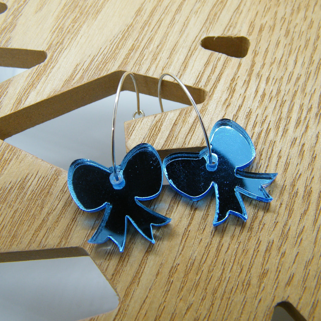 Blue mirrored bow hoops