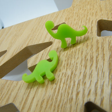 Green dinosaur stud earrings