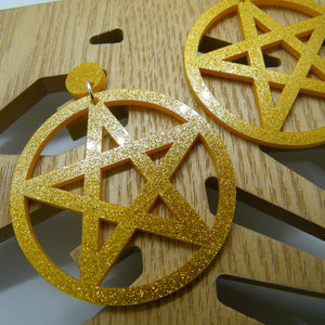Gold glitter pentagram statement earrings