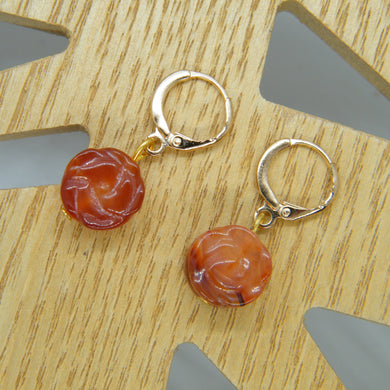 Orange flower huggy earrings