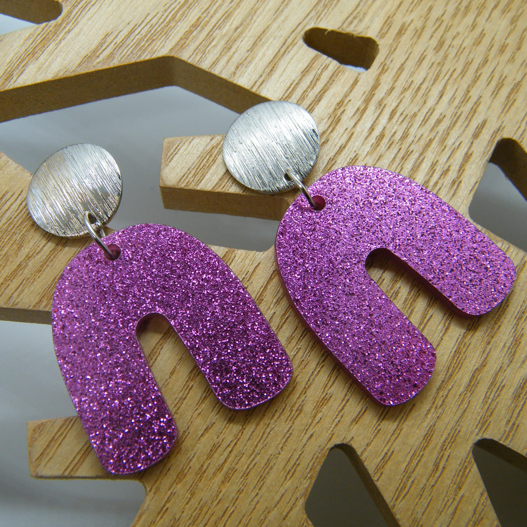 Pink glitter arch earrings