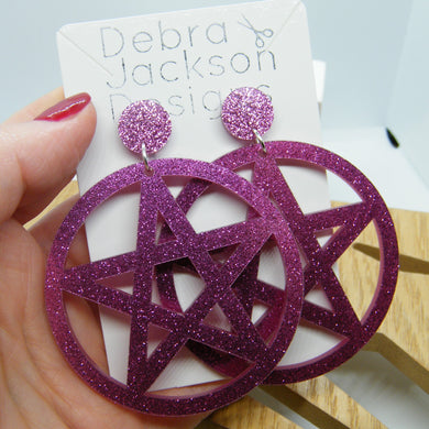 Pink glitter pentagram statement earrings