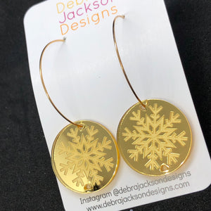 Gold snowflake hoop earrings