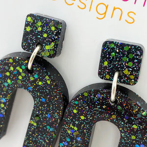 Black and glitter arch earrings