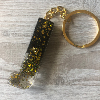Black and gold J keyring