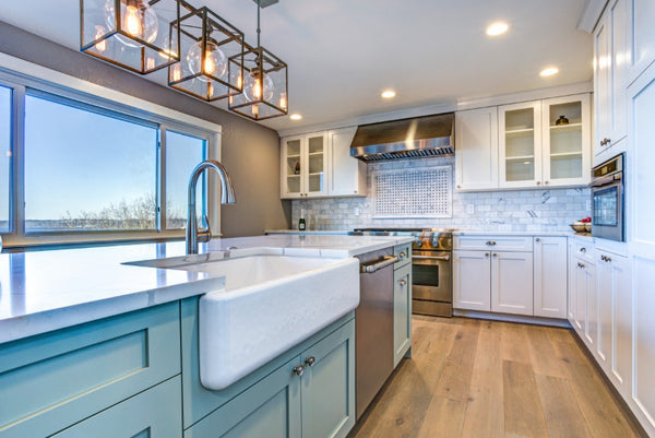 large-kitchen-with-white-farmhouse-sink-blue-cabinets-with-white-cabinets-featuring-brass-cabinet-hardware