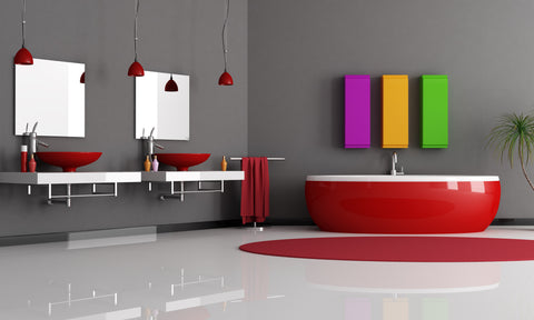 Funky bathroom with red soaker tub red sink bowls and grey walls
