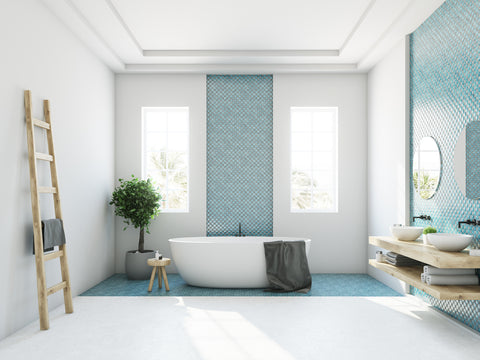 Bright bathroom with blue walls and white floor.
