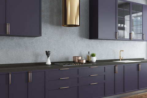 brushed brass on modern colored kitchen cabinets