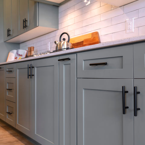 Shaker cabinets in a lush grey with black european bar pulls