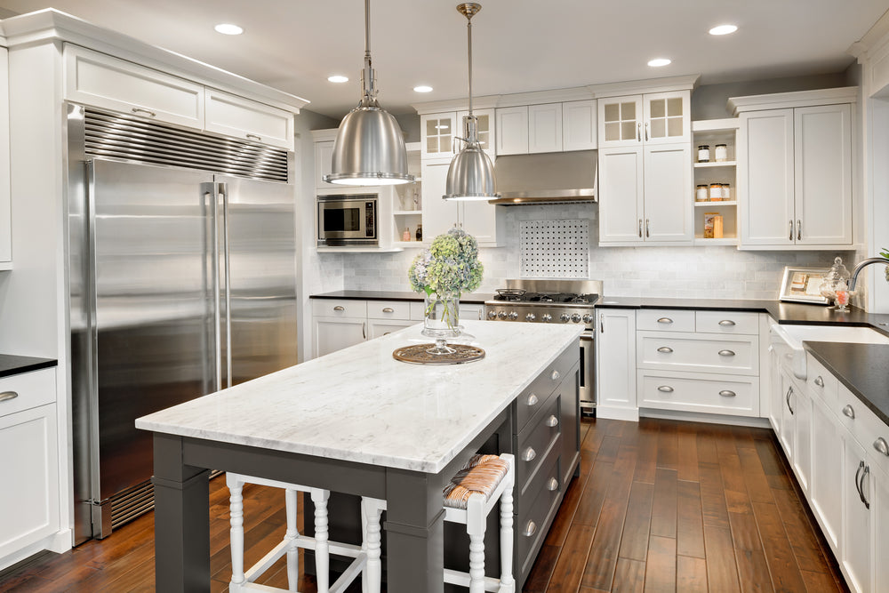 silver cup pulls and standard cabinet pull in white kitchen