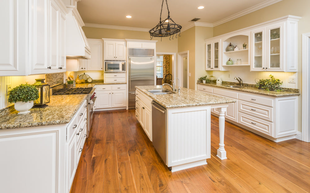 Kitchen cabinet doors with knobs and kitchen drawers with pulls.