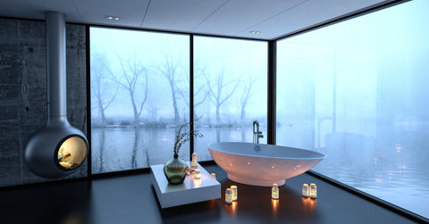 Spa bathroom with black floor, lighting and fireplace