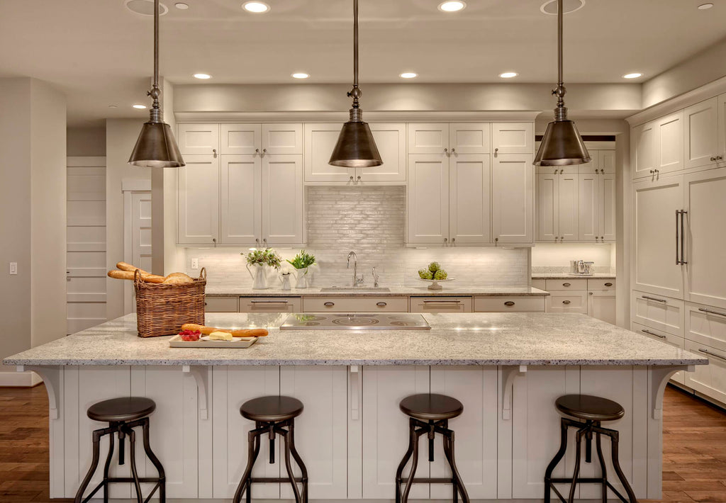 Kitchen with cup pulls, cabinet knobs and appliance pulls