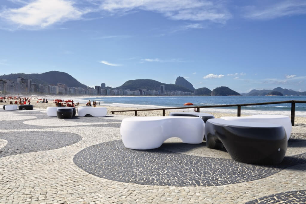 white black glossy concrete organic shape bench seating outdoors