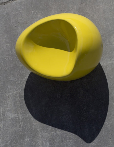 yellow smooth glossy concrete stone armchair indoor outdoor street furniture