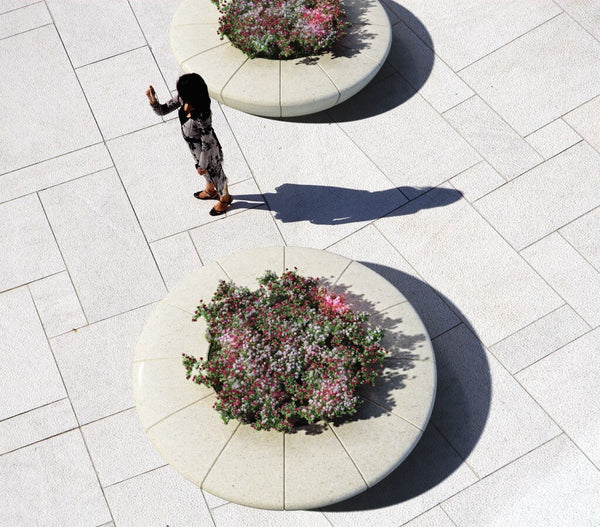 white granite round planter flowerbed with bench seating outdoor tree stone terrazzo