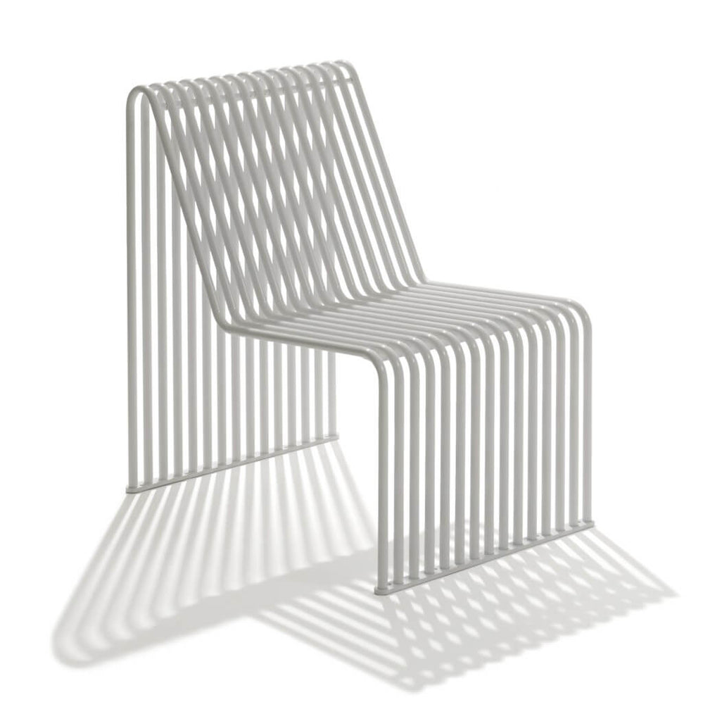 white armless chair backrest outdoor indoor metal tubing curved seat