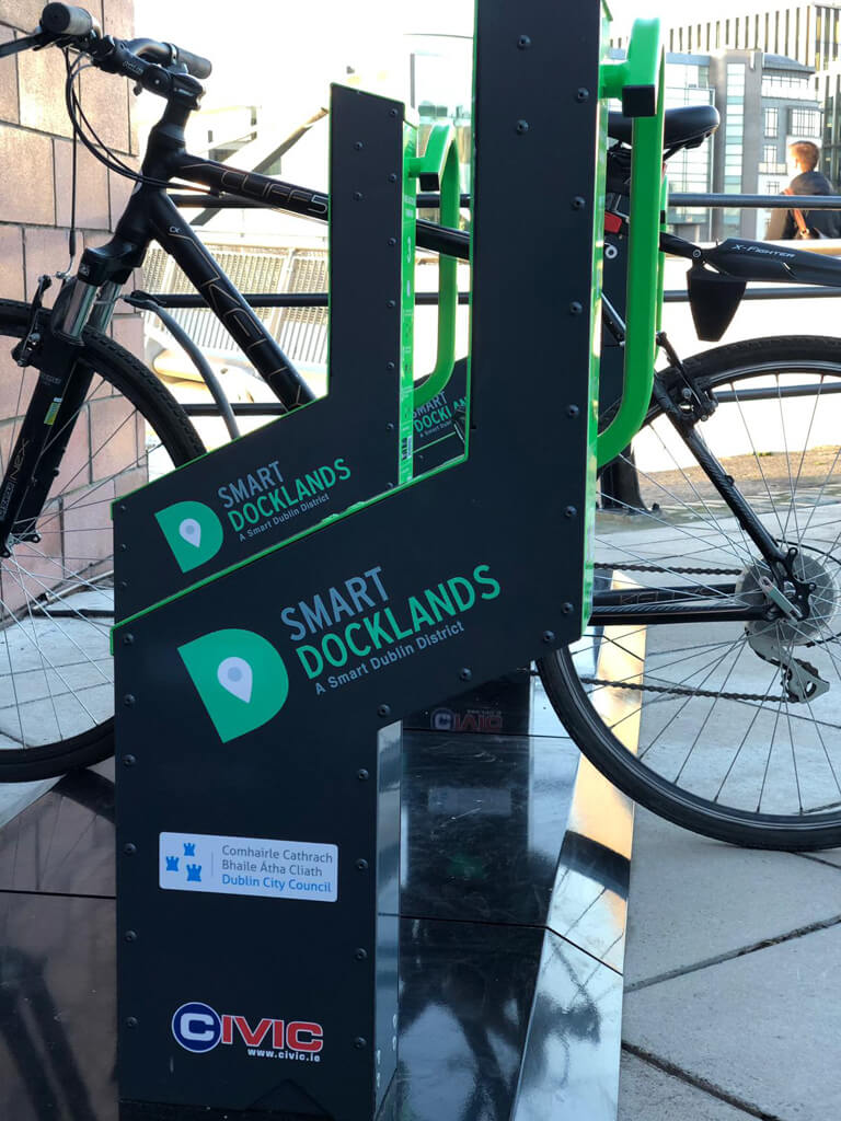 urban transit bike parking solution technology phone app locking bike parking solar powered