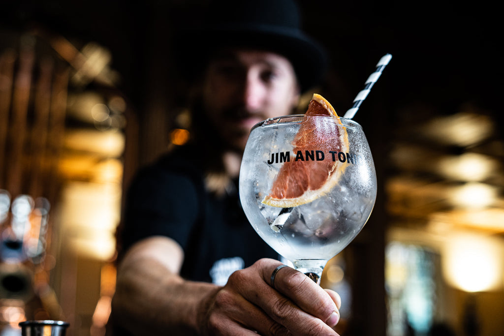 pink grapefruit gin cocktail being served by barman