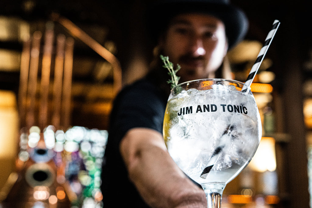 mixologist serving mediterranean gin and tonic cocktail