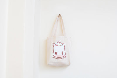 Tiny Rabbit Hole - Yuni Chan the Rainbow Unicorn Beige Tote Bag