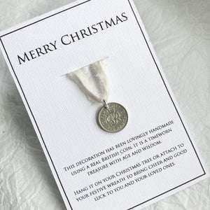 Coins are mounted on a gift card