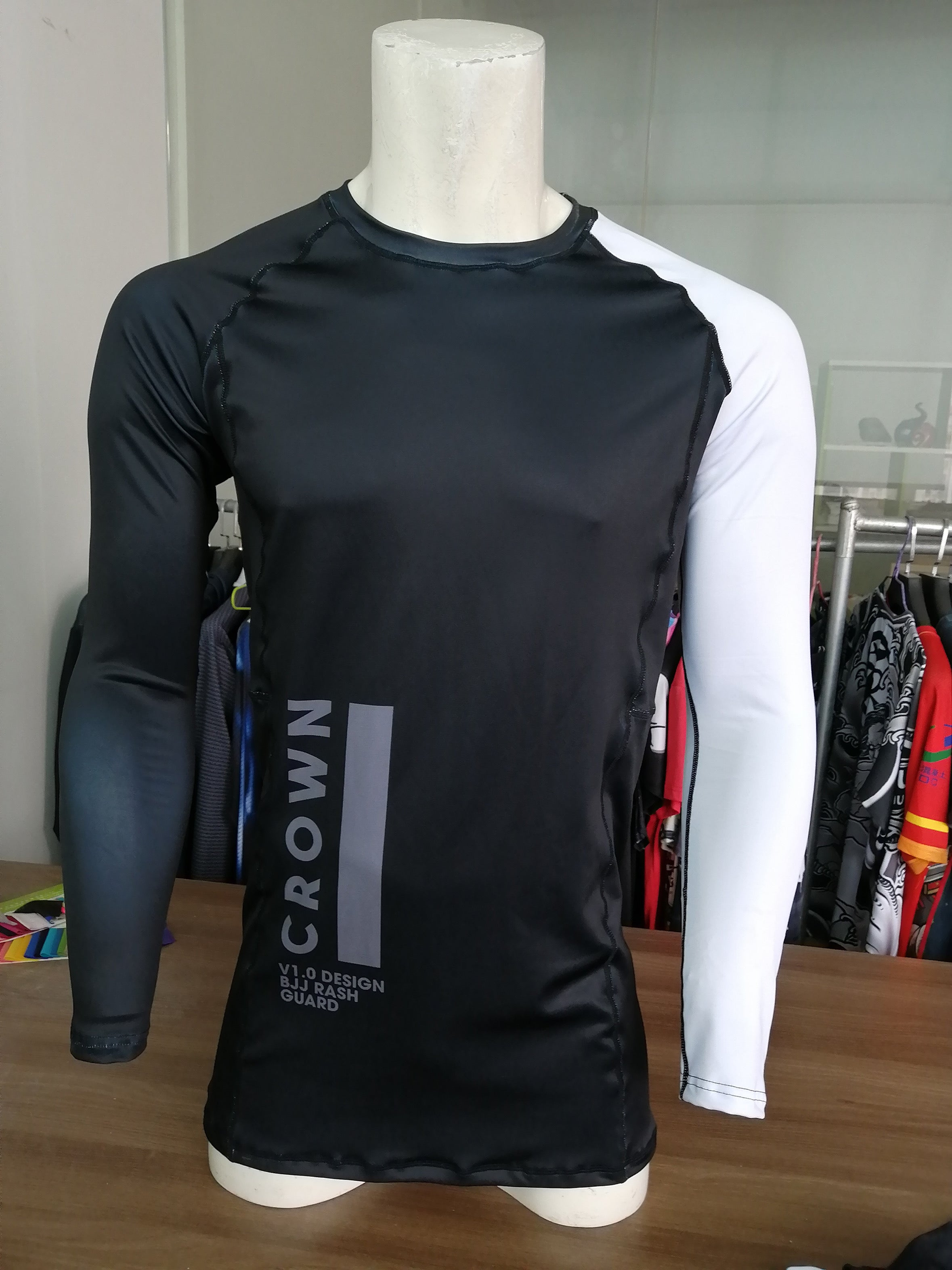 Actual prototype of the V1.0 long sleeve rash guard, but with black stitching.