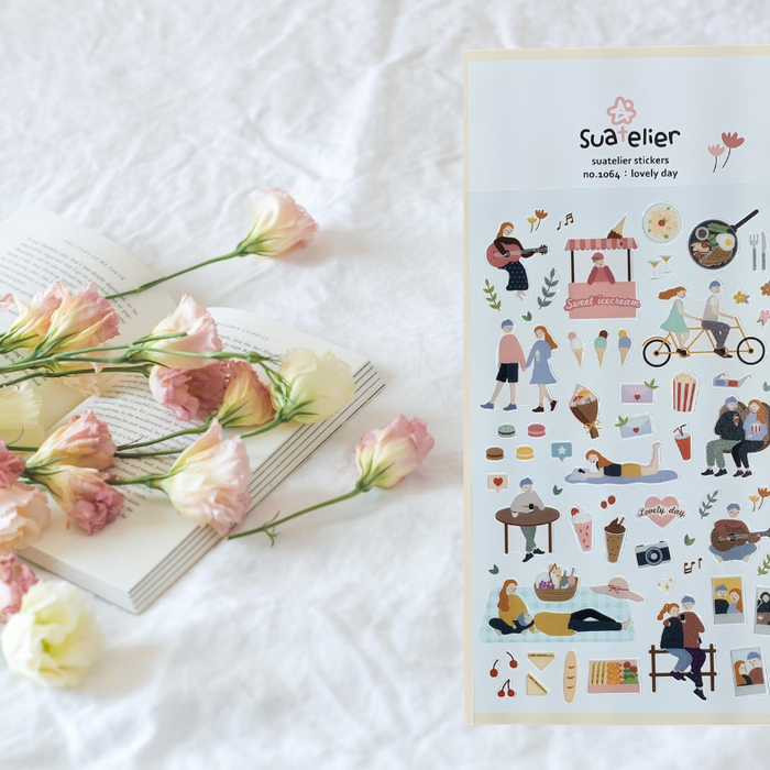Suatelier Lovely Day Sticker Sheet from Script + Sea featuring ice cream, people, music, and snack stickers on a white sheet background with roses and a book.