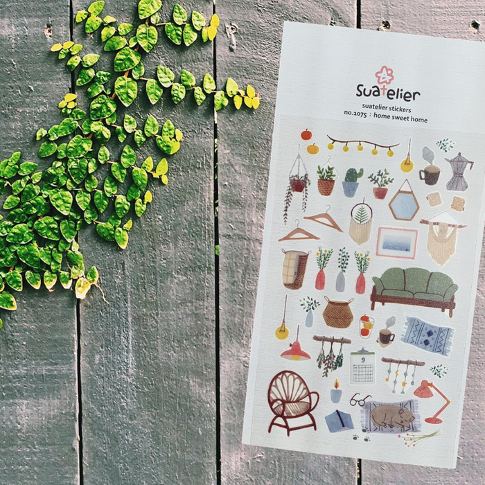 Suatelier Home Sweet Home Sticker Sheet by Script + Sea featuring lamps, decor, plant, and furniture stickers on a rustic wood background.