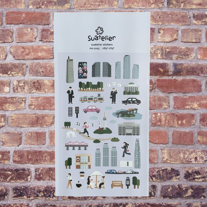 Suatelier City! City! Sticker Sheet by Script + Sea featuring skyscrapers, cars, and people on a brick wall background.