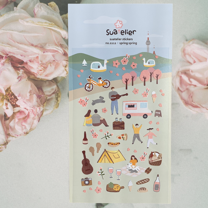 Suatelier Spring Spring Sticker Sheet by Script + Sea featuring cherry blossom tree, picnic, and music stickers on a plain background with pink flowers.