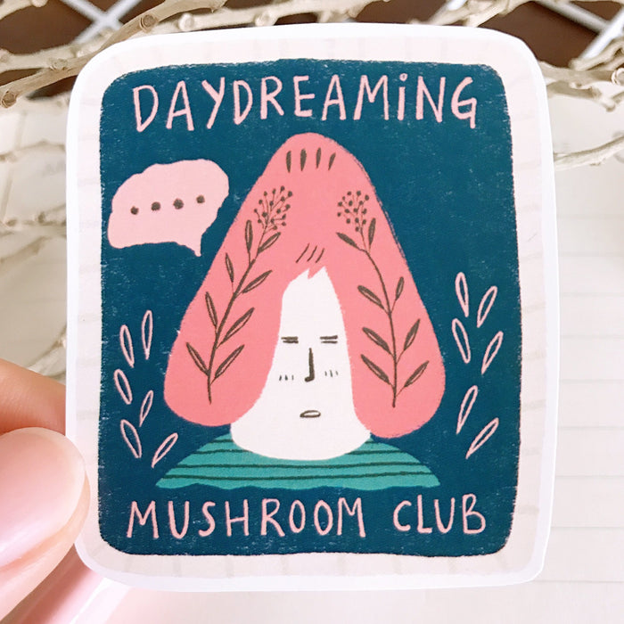 Daydreaming is a cute laptop sticker by Mushroom Mountain featuring a member of the Mushroom Village