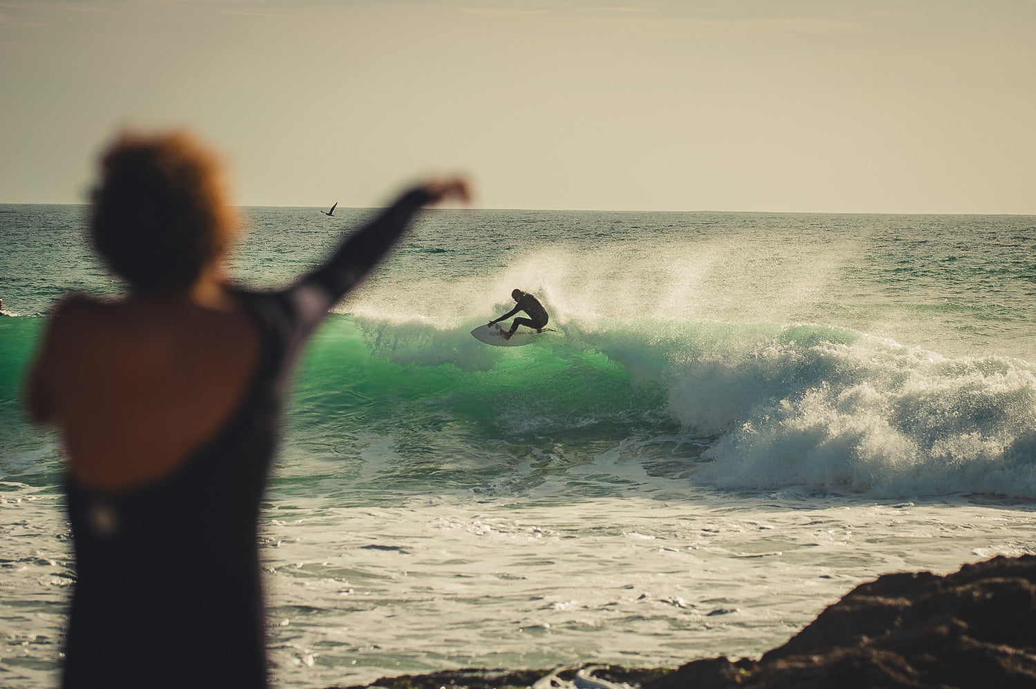 surfer putting wetsuit on