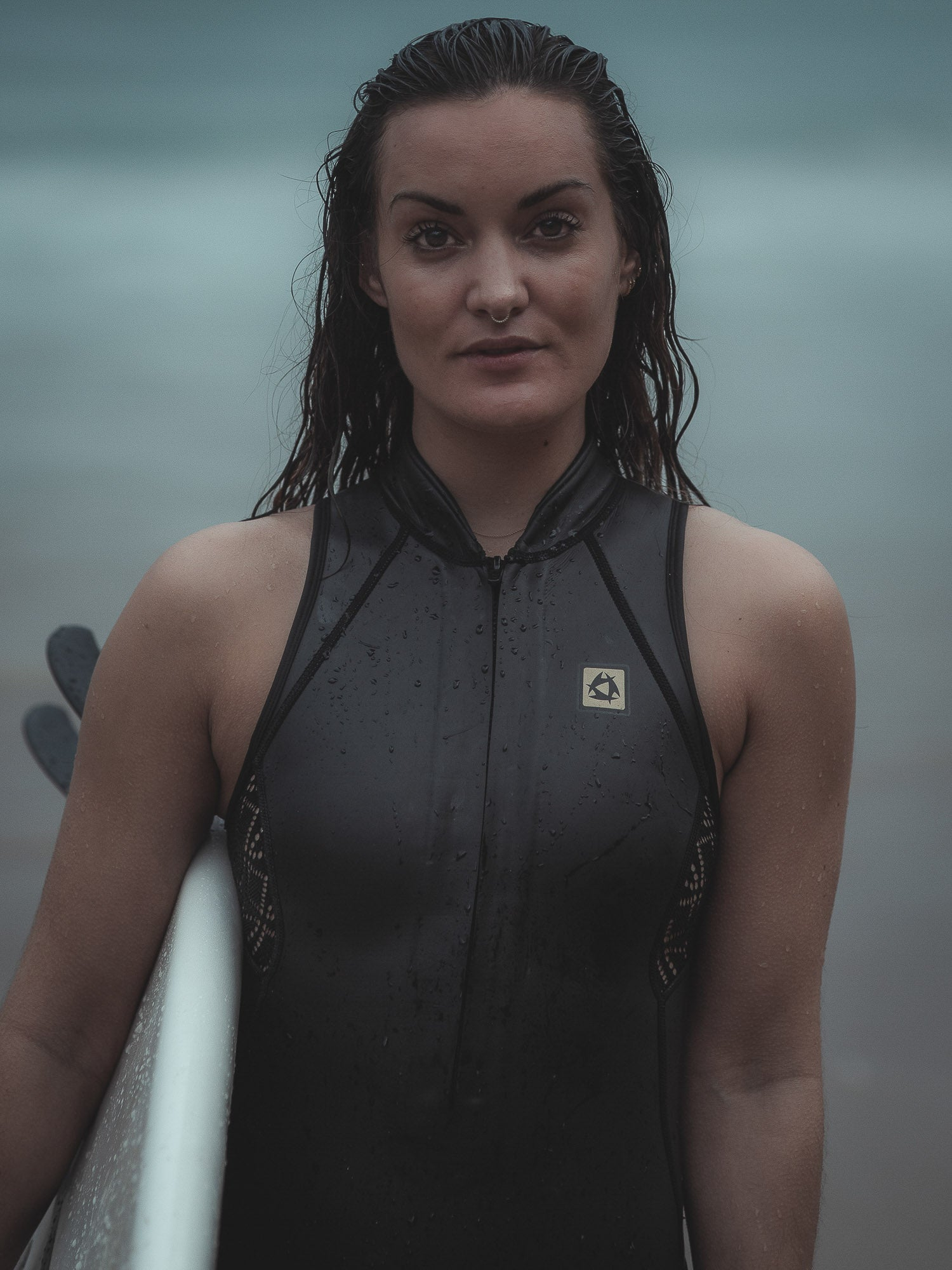 surfer girl in wetsuit