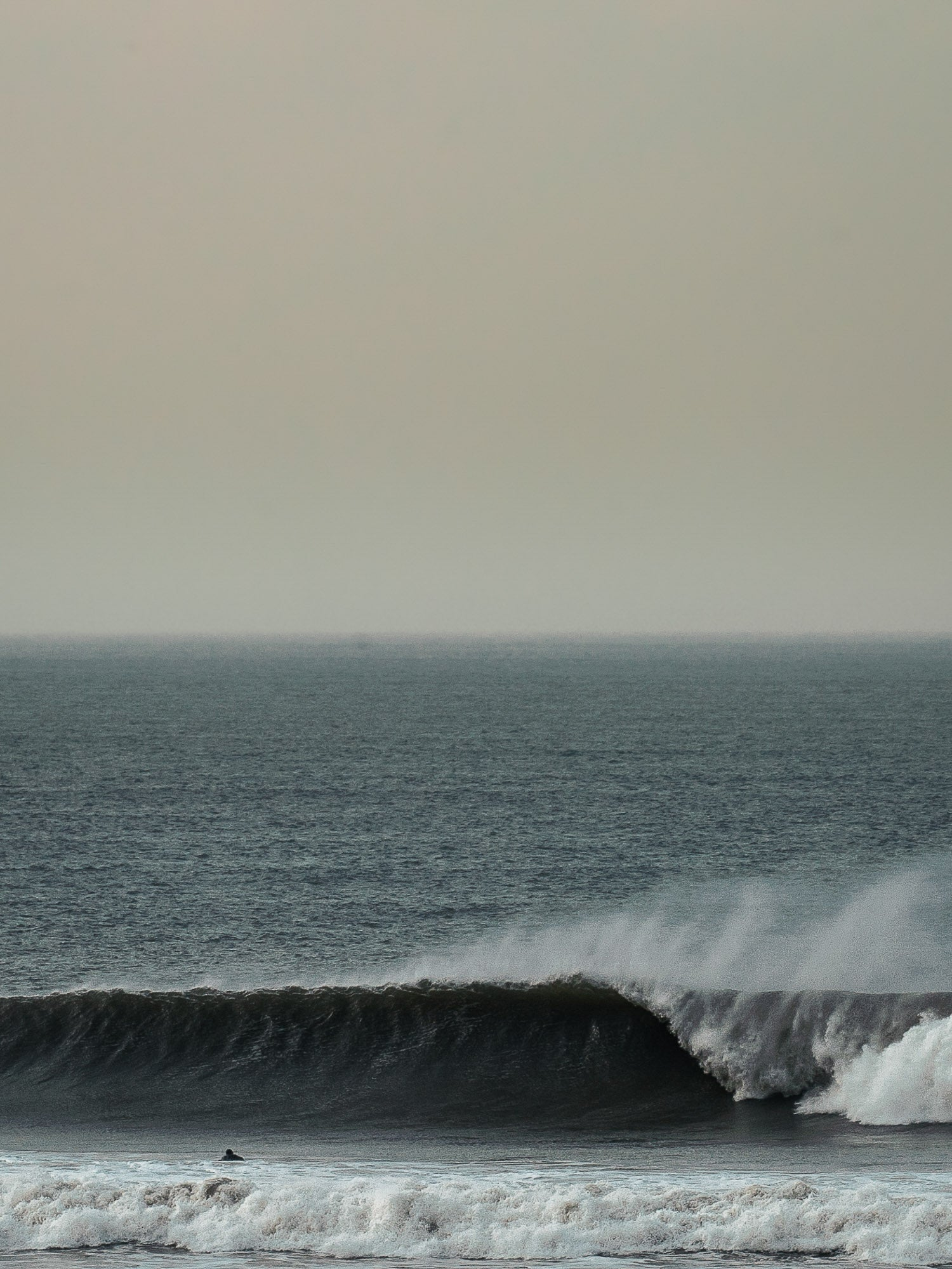Surfing waves at Woolacombe
