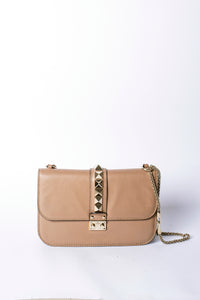 Glam Lock shoulder bag by Valentino.