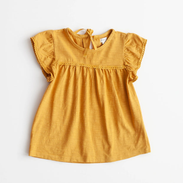 Simple yellow top for girls, sold in Asheville, North Carolina.