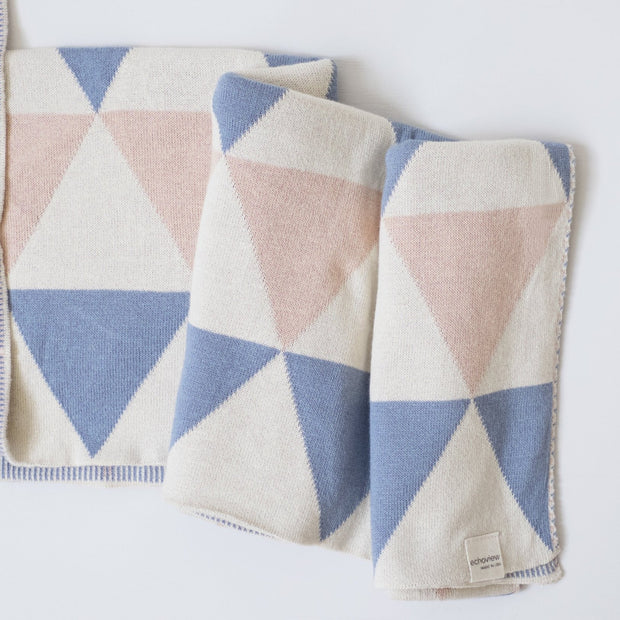 Beautiful baby blanket with blue and pink pattern that is made from organic cotton in Asheville, North Carolina.