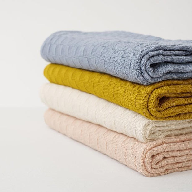 Organic baby blanket in soft colors that is made locally in Asheville, North Carolina.