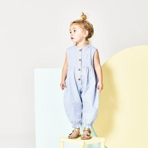Unisex jumpsuit pantaloon with blue stripes and wooden buttons in Asheville, North Carolina.