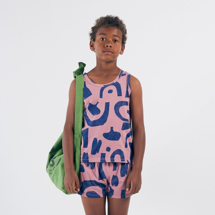 Big kid wearing organic cotton tank top with blue pattern, sold in Asheville, North Carolina.