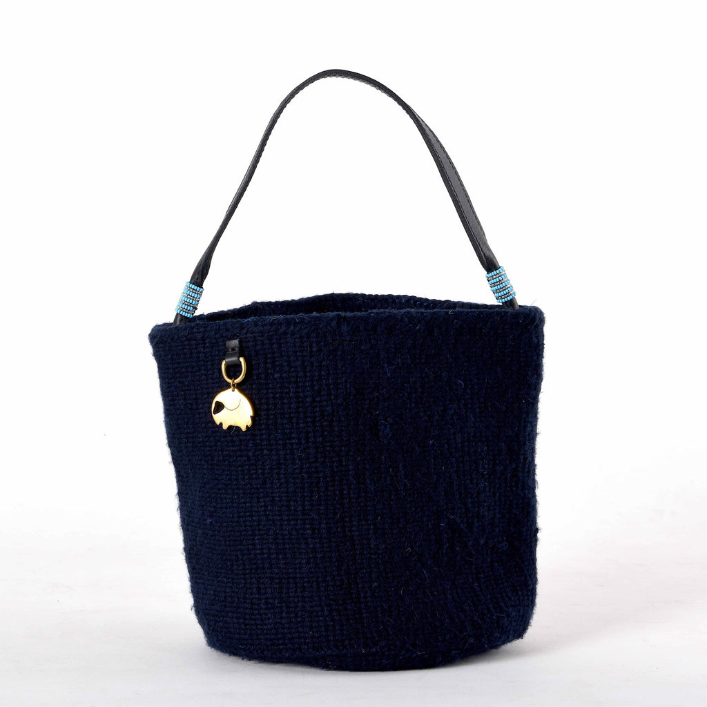 Handwoven Bucket Bag in Dark Blue. Your sustainable and chic bag made from sustainable materials - Sisal, Recycled Wool, Leather and Maasai Beads