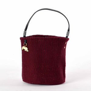 Handwoven Bucket Bag in Burgundy Red. Your sustainable and chic bag made from sustainable materials - Sisal, Recycled Wool, Leather and Maasai Beads