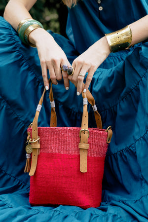 Hot Pink Handwoven Safari Bag, contrasted with blue. Your sustainable everyday bag made from sustainable materials - Sisal, Recycled Wool, Leather and Maasai Beads