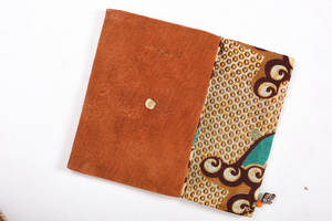 Inside of the Sustainable Clutch Bag in White. Made from Malian Cotton Mud Cloth and Banana Bark